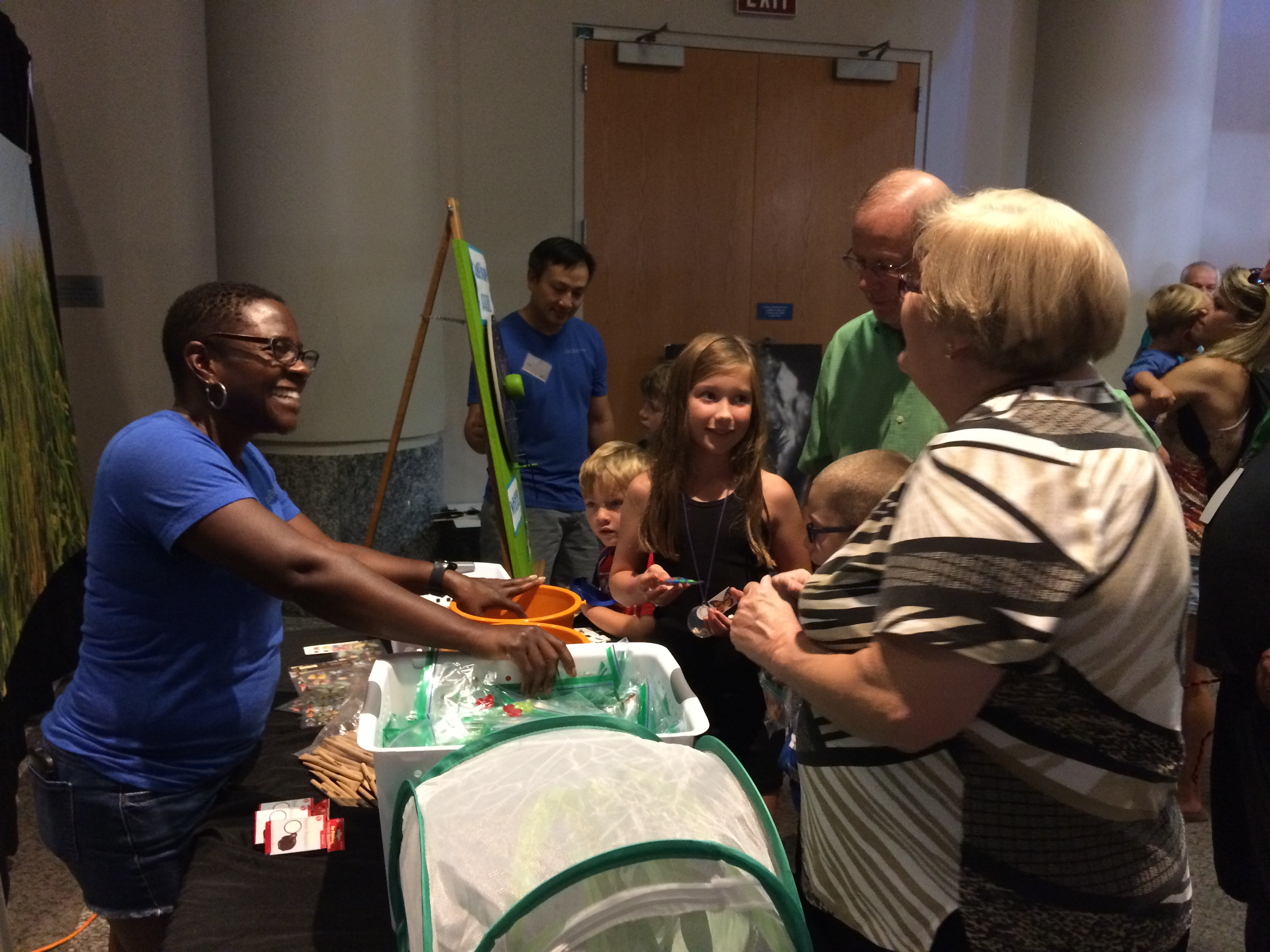 Sinnika talks with visitors to the AgBiome booth at the 2017 BugFest event at the Museum of Natural Sciences in Raleigh, NC.